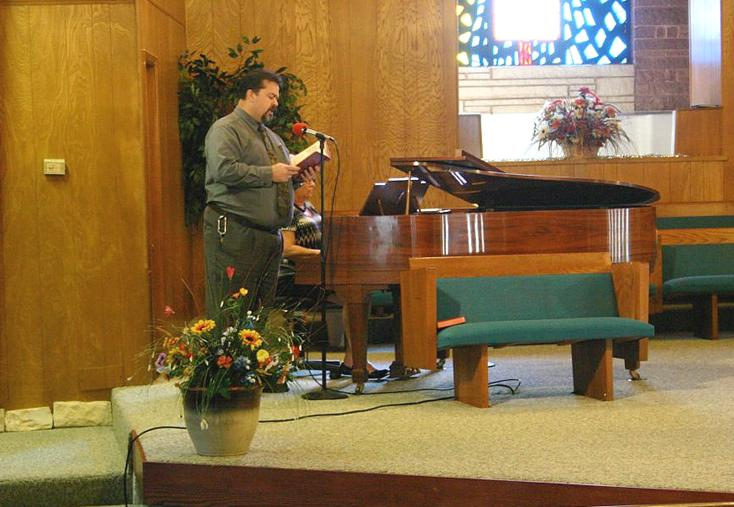 Song leader, Travis Nelson, singing a special